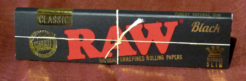 "Raw Classic Black King Size Slim Papers (£1.15) – 32 natural, unrefined, unbleached, ultra thin leaves; made in Spain. ""This unique artisan paper is so thin that it's virtually flavourless and allows you to truly taste your smoke at a never before experienced level."""