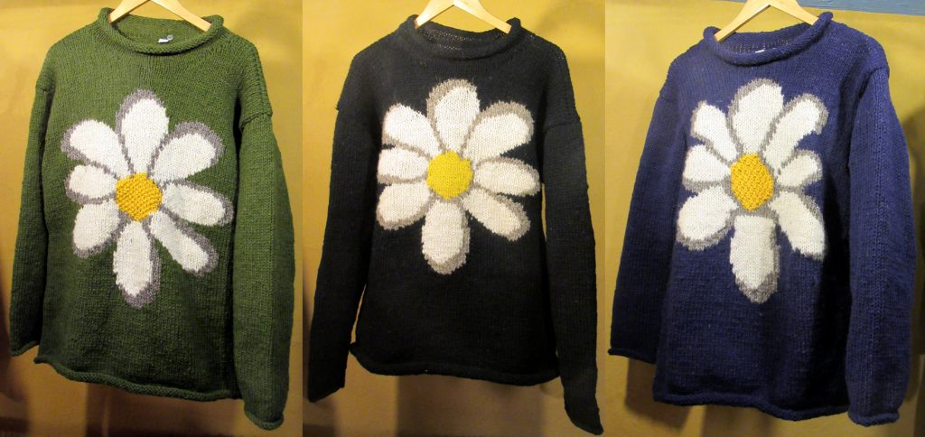 Large Daisy Woollen Jumpers (£42) – Made in Nepal. Available in green, black and blue.