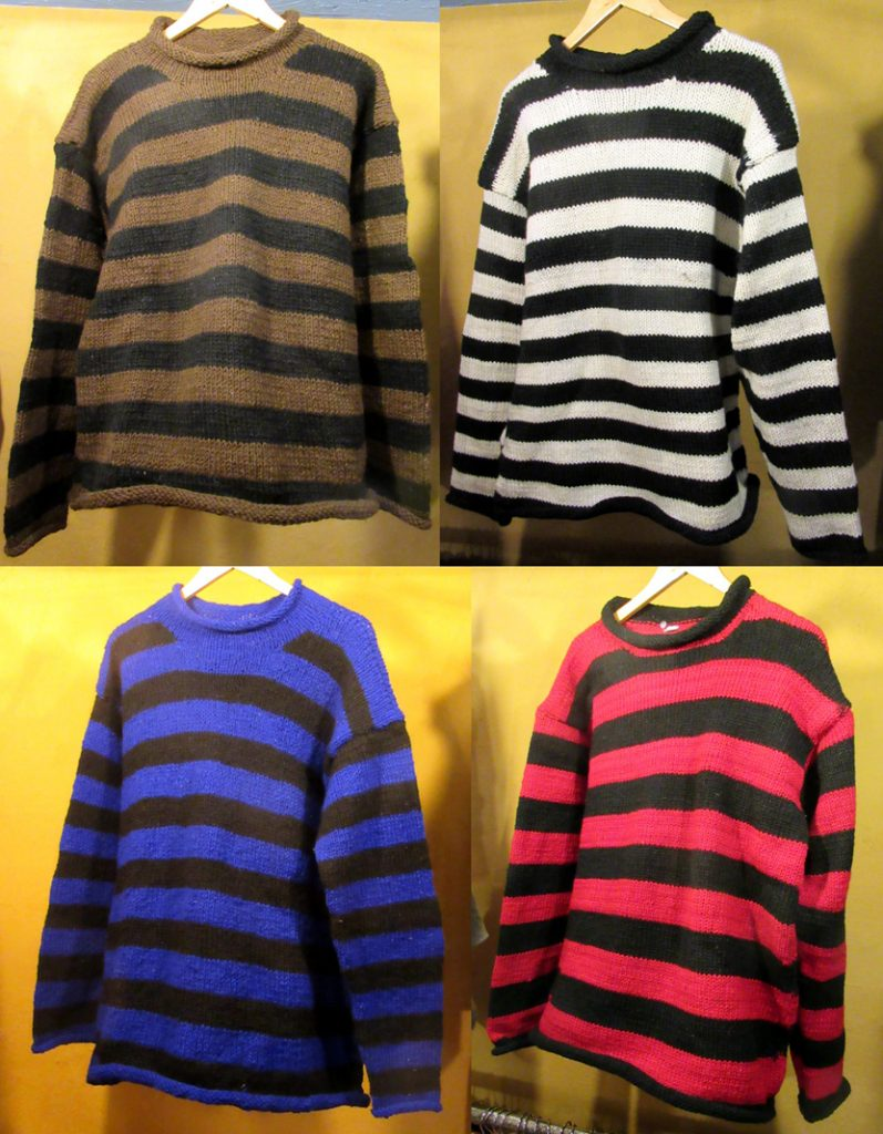 Large Striped Woollen Jumpers (£42) – Made in Nepal. Available in blue and black, brown and black, green and black, red and black, and white and black.